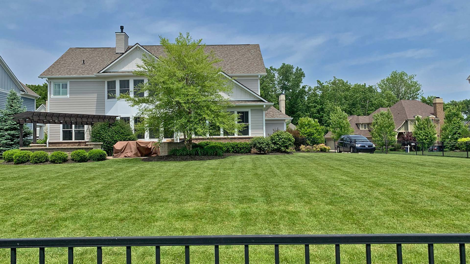 Beautifully trimmed and pruned hedges and mowed lawn of a Noblesville homeowner.