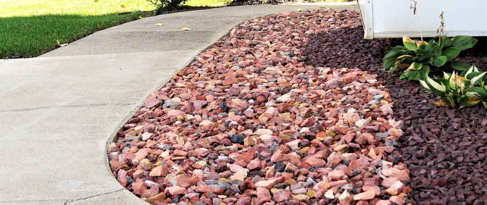 New rock installation by Spider Lawn & Landscape at a home in Carmel.